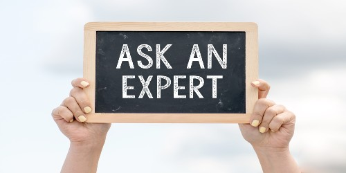 Someone holding an 'ask an expert' sign